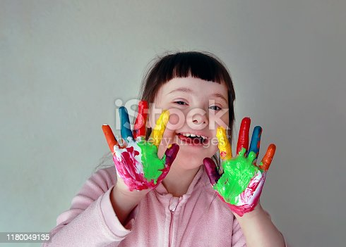 istock Cute little girl with painted hands. Isolated on grey background. 1180049135