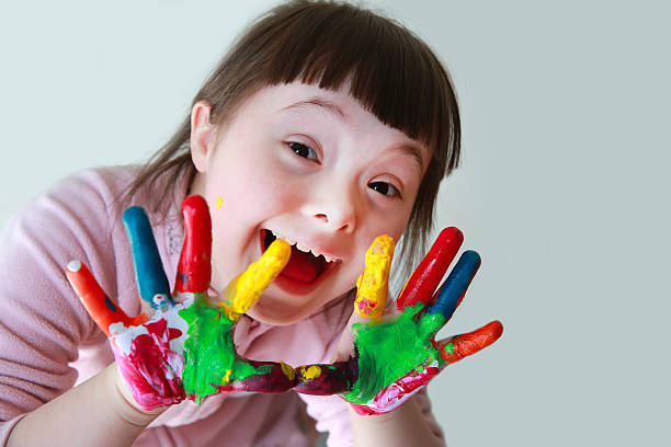 Cute little girl with painted hands stock photo