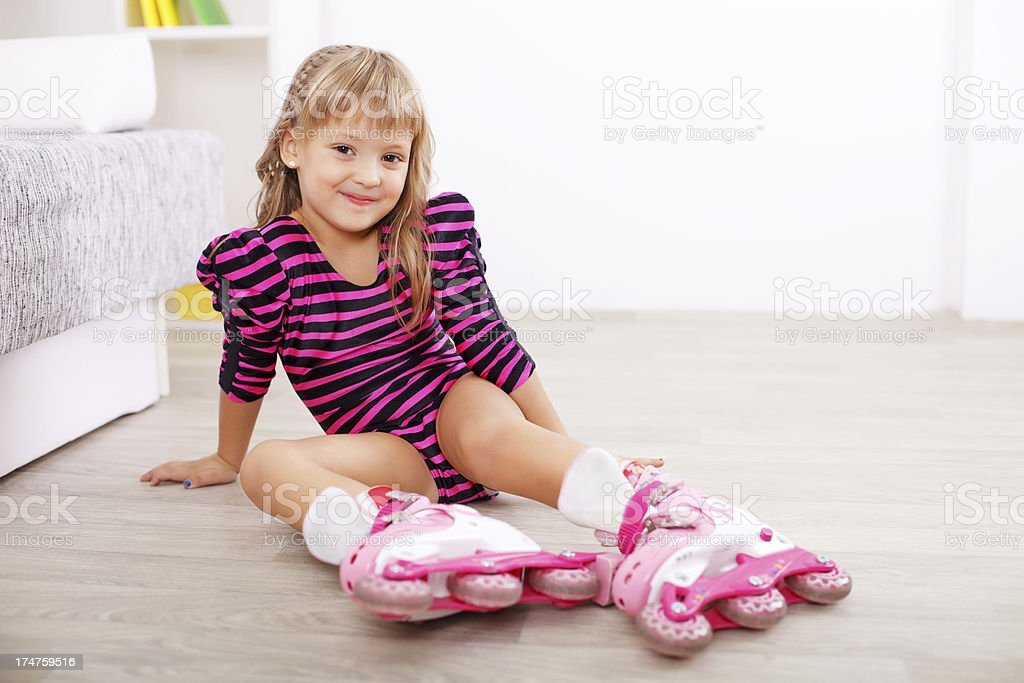 Cute little girl with roller blades. royalty-free stock photo