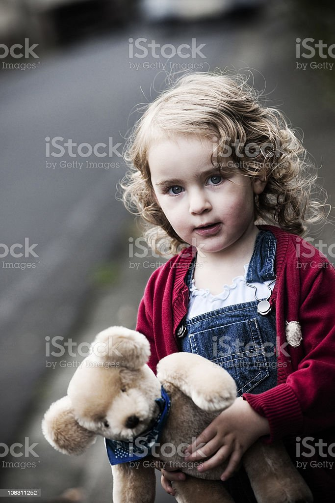 Cute little girl with teddy royalty-free stock photo