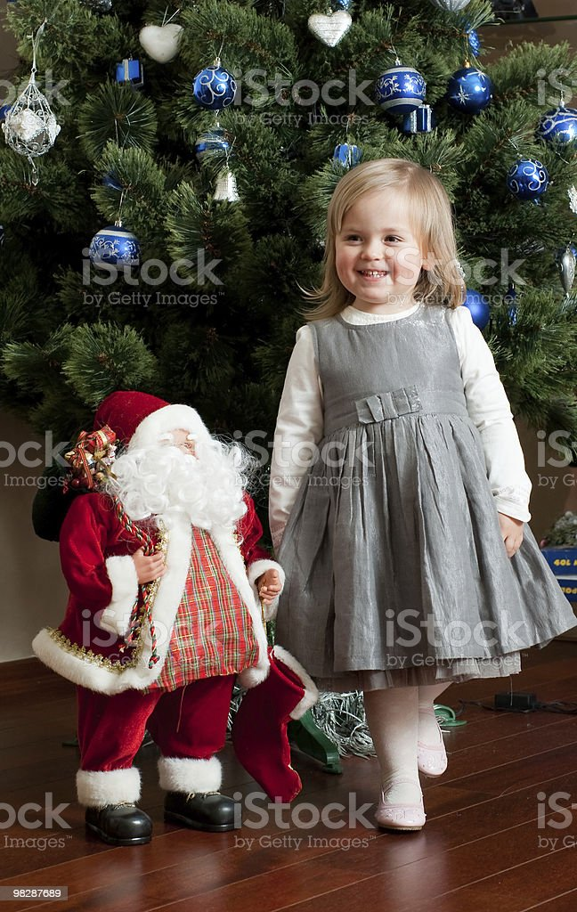 Cute little girl with toy Santa Claus royalty-free stock photo