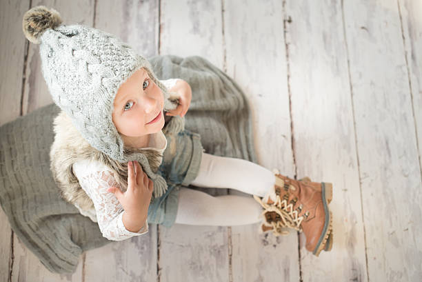 Cute little girl with winter hat stock photo