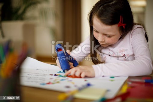 Cute little girl working on creative art and craft project