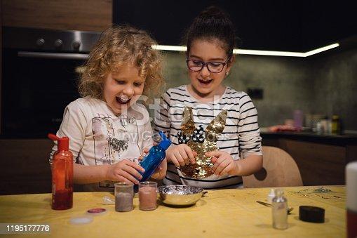 Little girls making homemade slime toy