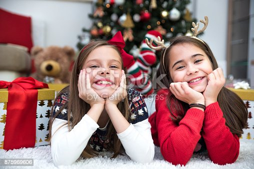 1062609644 istock photo Cute little girls on Christmas eve 875969606