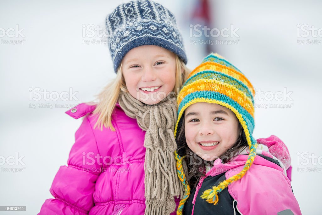 Cute Little Girls Outside in the Snow stock photo