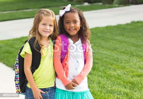 istock Cute Little girls walking to school together 463344637