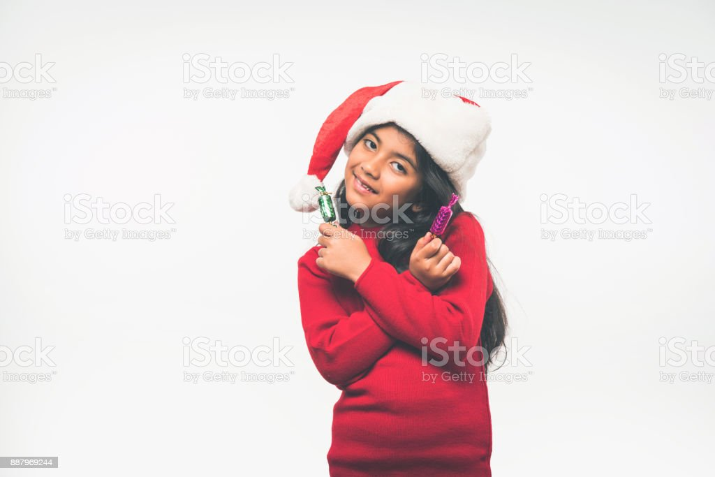 Cute Little Indian Girl Holding Christmas Gifts Stock Photo & More Pictures  of Beauty