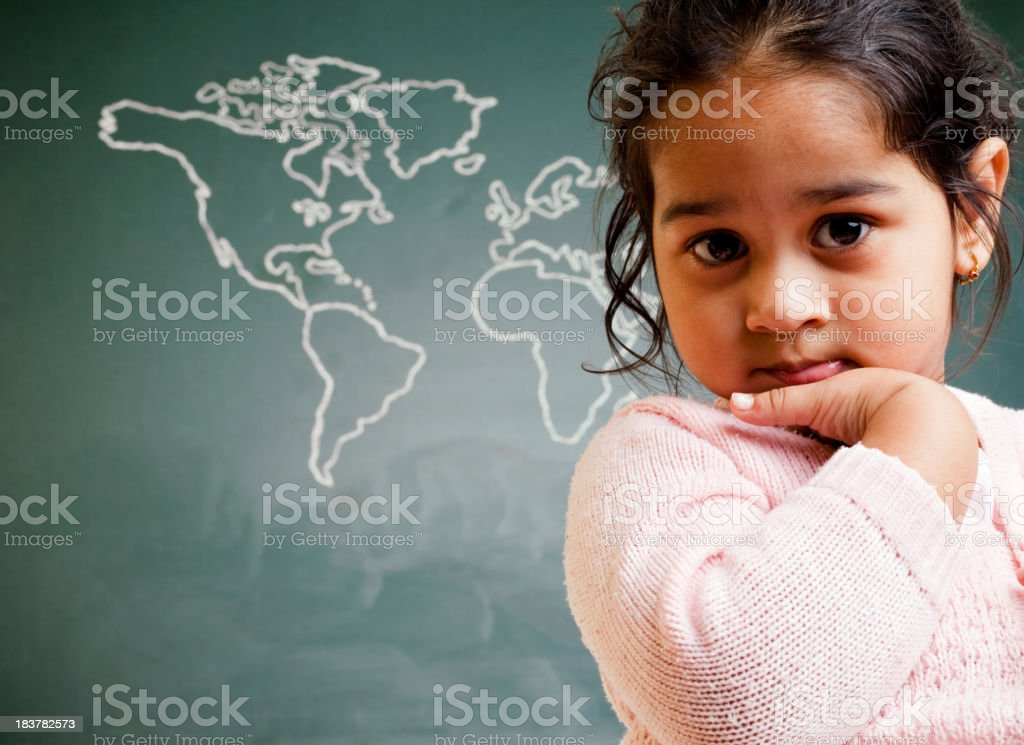 Cute Little Indian Preschool Girl in Front of World Map royalty-free stock photo