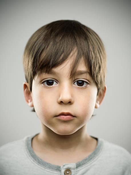 Cute little kid looking at camera stock photo