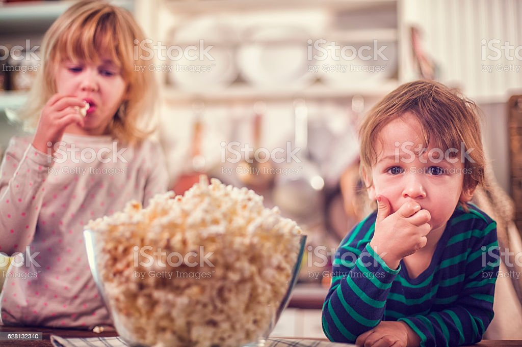 Cute Little Kids Eating Homemade Popcorn stock photo