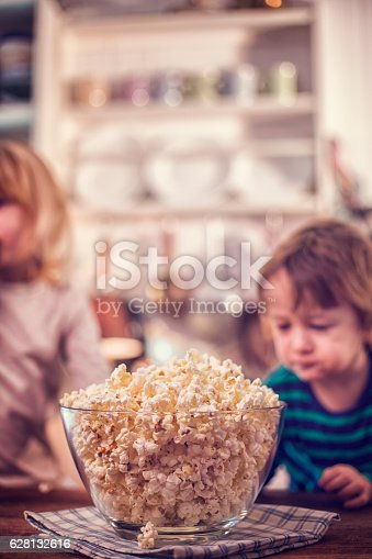 istock Cute Little Kids Eating Homemade Popcorn 628132616