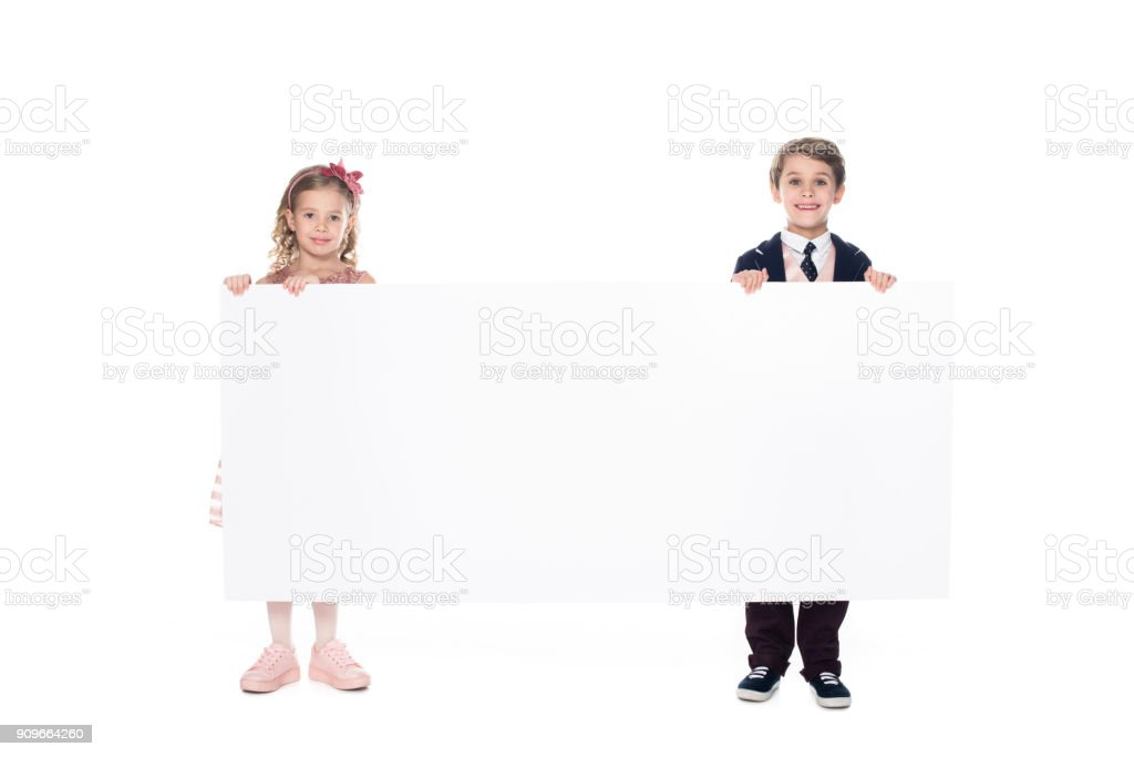 b3ef914b6c4a cute little kids holding blank banner and smiling at camera isolated on  white royalty-free