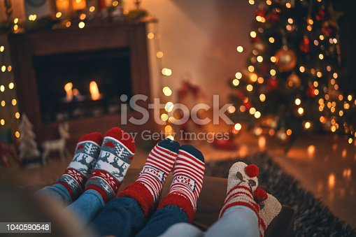 Cute Little Kids in Christmas Socks Sitting in a Cosy Christmas Atmosphere