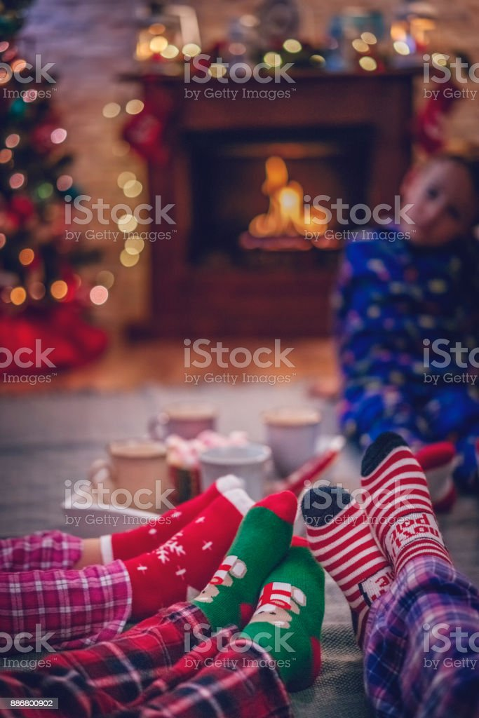 Cute Little Kids In Pyjamas And Christmas Socks Drinking Hot ...