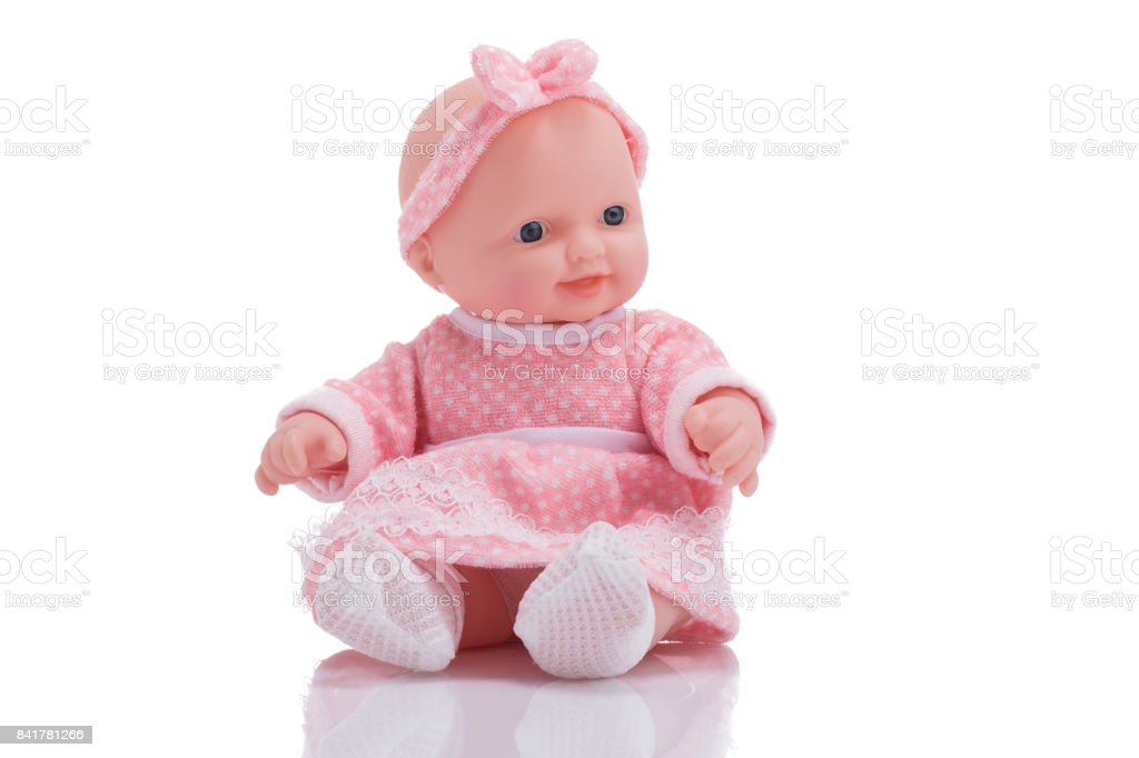 Cute little plastic baby doll isolated on white background stock photo