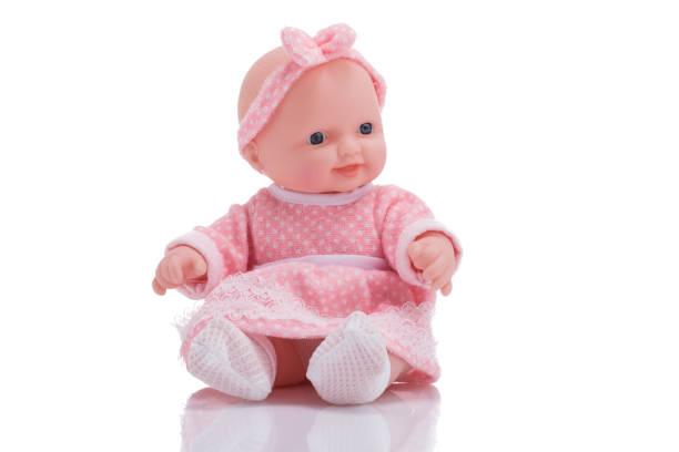 孤立在白色背景上的可愛小塑膠娃娃 - 公仔 個照片及圖片檔