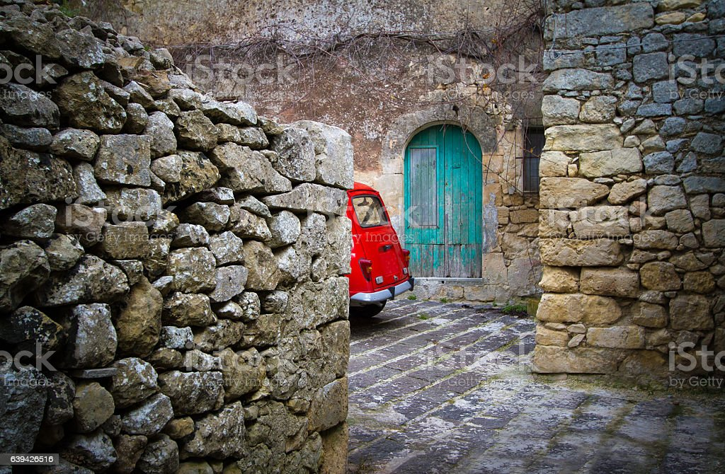 Cute Little Red Vintage Car, Ancient Cobbled Piazza, Stone Wall