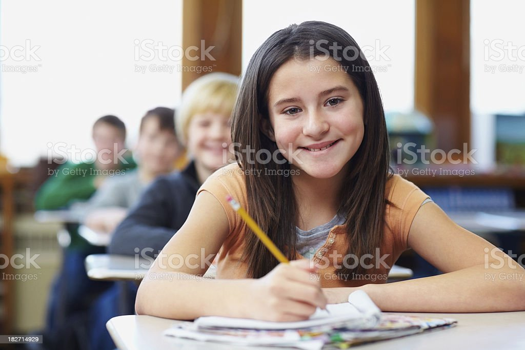 Cute little school at the classroom stock photo