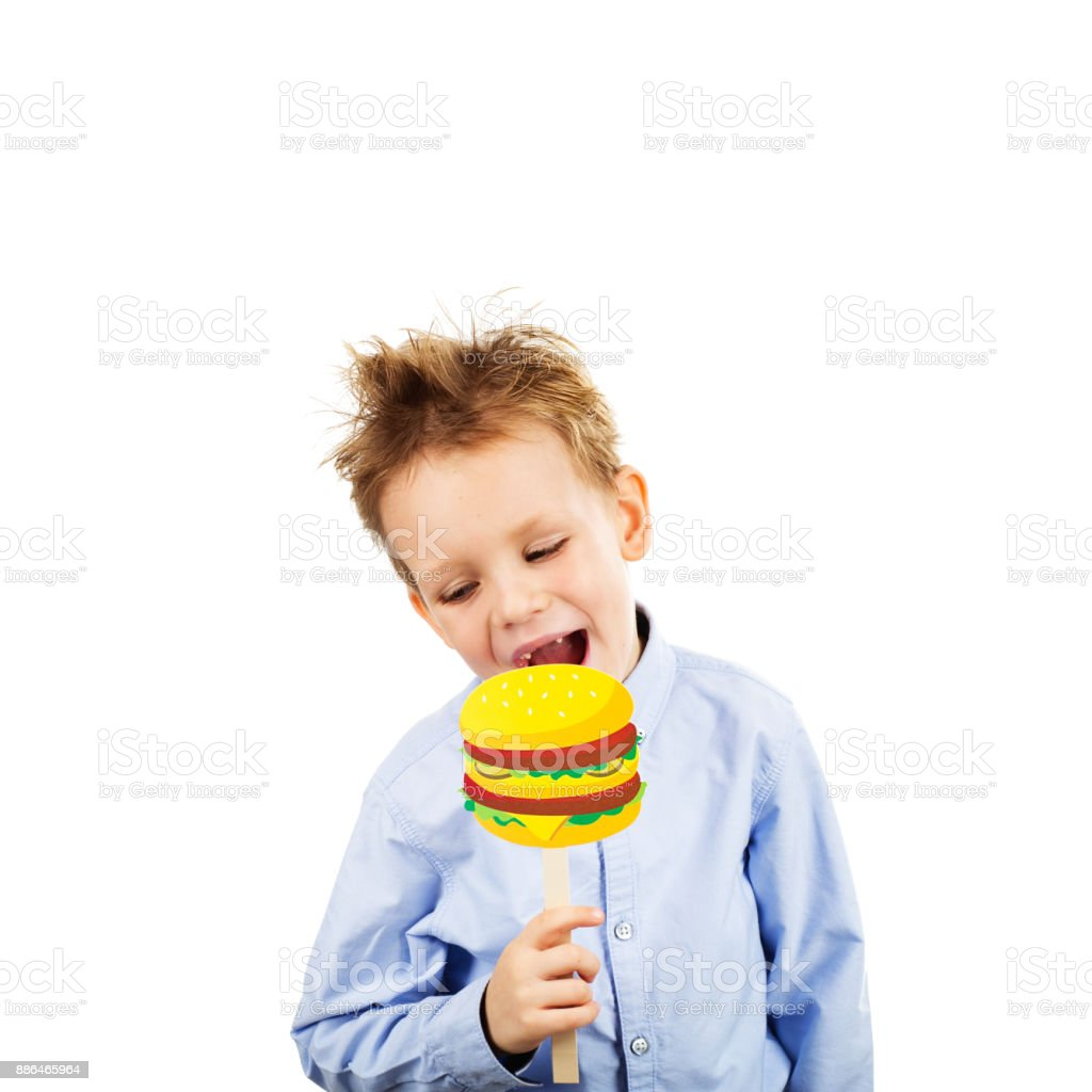 cute little school boy with fake paper burger isolated on a white