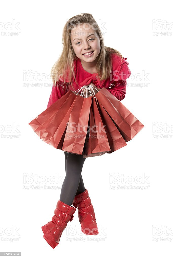 Cute Little Shopaholic Girl With Full of Bags Smiling royalty-free stock photo