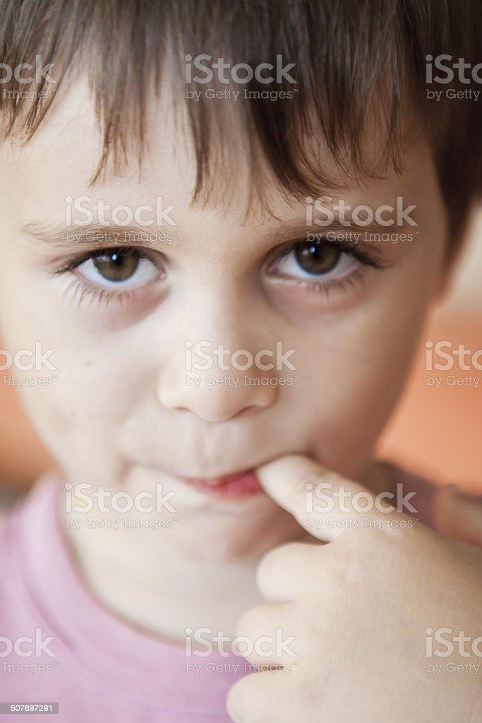Cute little shy boy stock photo