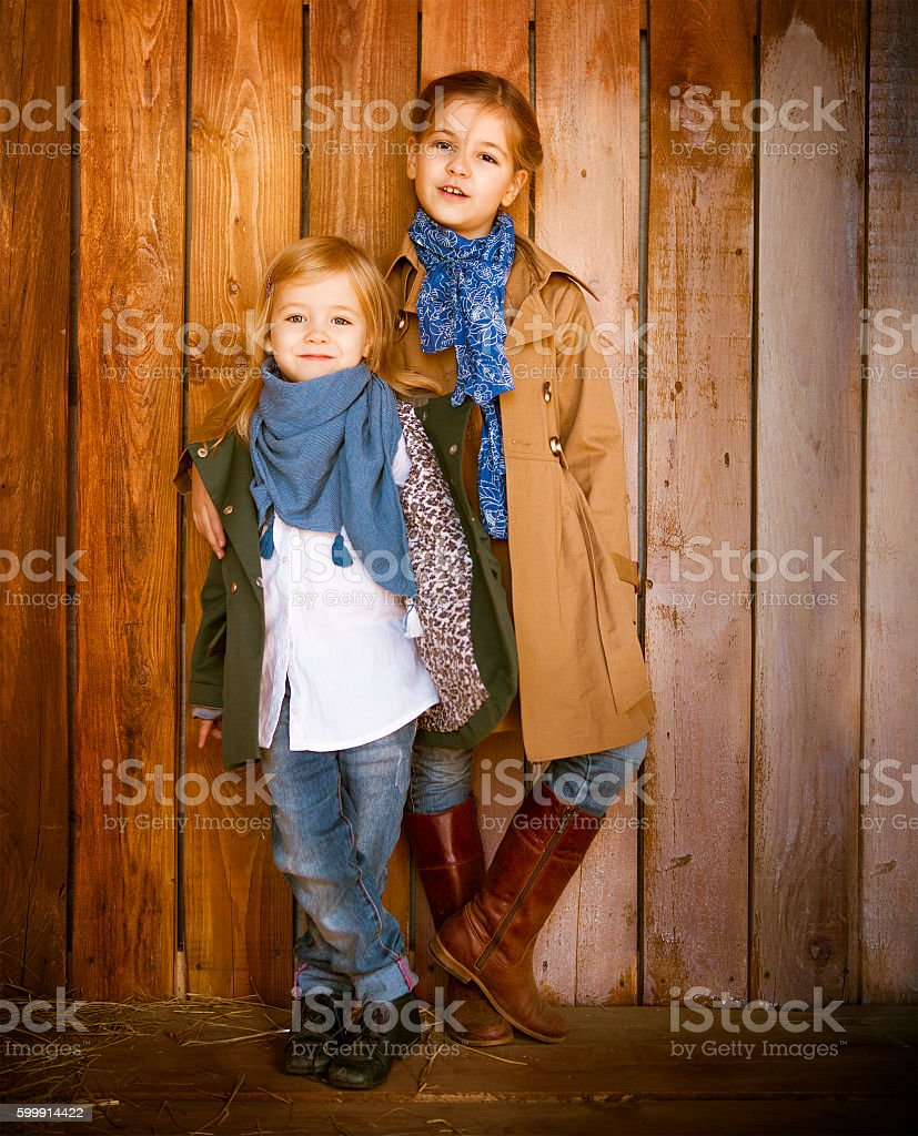 Cute little sisters wearing autumn  clothes stock photo