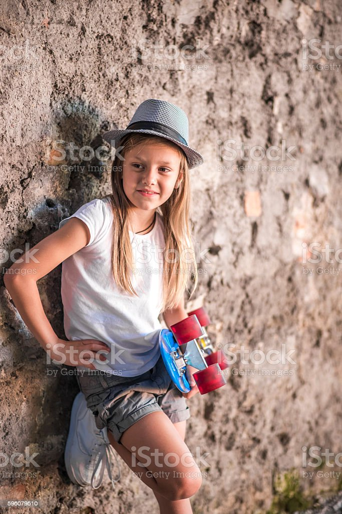 Cute little skateboarder royalty-free stock photo