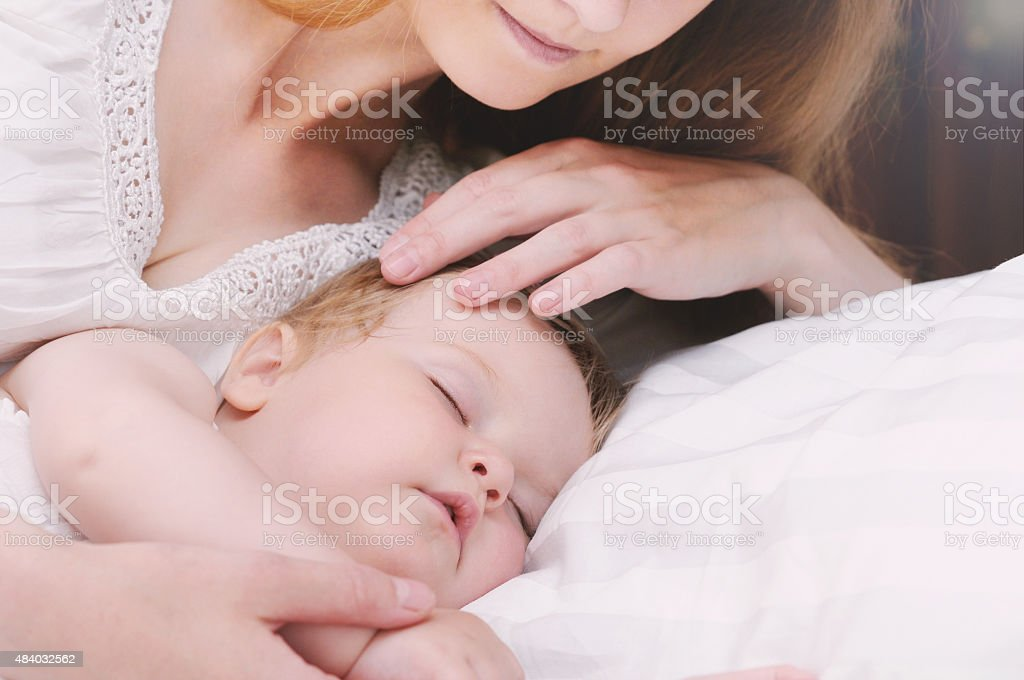 Cute Little Sleeping Baby Girl With Her Caring Mother Stock Photo Download Image Now Istock