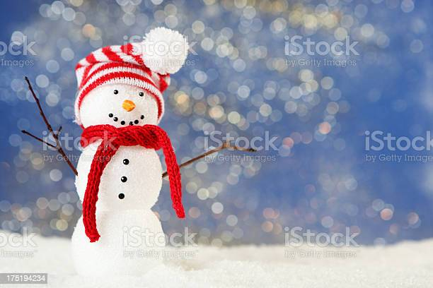 A Cute Little Snowman Wearing A Hat And Scarf Stock Photo - Download Image Now