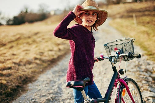 istock Cute little ten year old girl riding bicycle on countryside. 1148638138