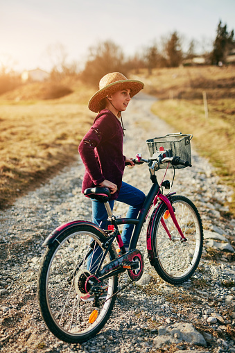 istock Cute little ten year old girl riding bicycle on countryside. 1173278479