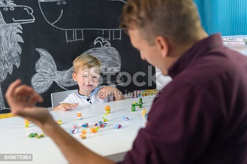 843899350istockphoto Cute little toddler boy at child therapy session. 849675984