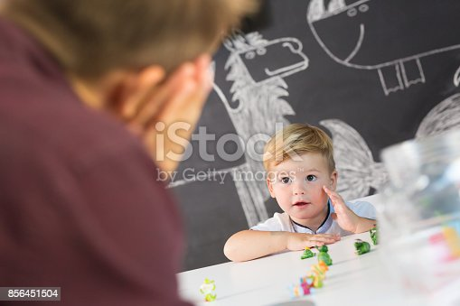 843899350istockphoto Cute little toddler boy at child therapy session. 856451504