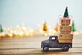 Cute little truck with gift stack and Christmas tree