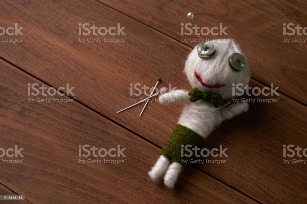 Cute Little Voodoo Doll with pins.Copy space. stock photo