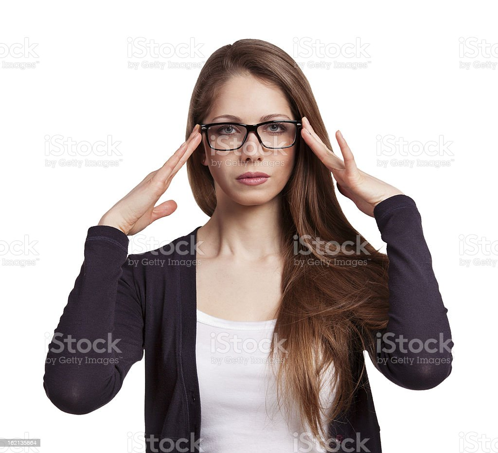 Cute long-haired girl in glasses focused royalty-free stock photo