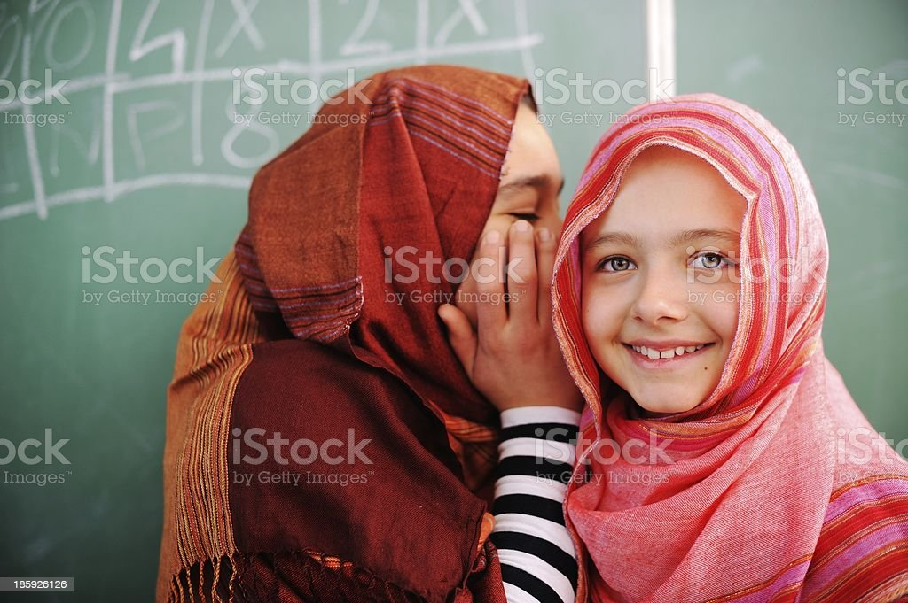 Cute lovely school children at classroom having education activi royalty-free stock photo