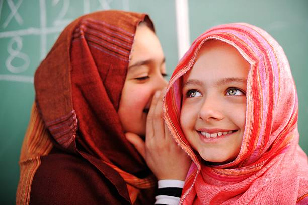 cute lovely school children at classroom having education activi - arabic girl stock photos and pictures