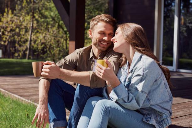 Cute man and woman having romantic feelings outdoors stock photo