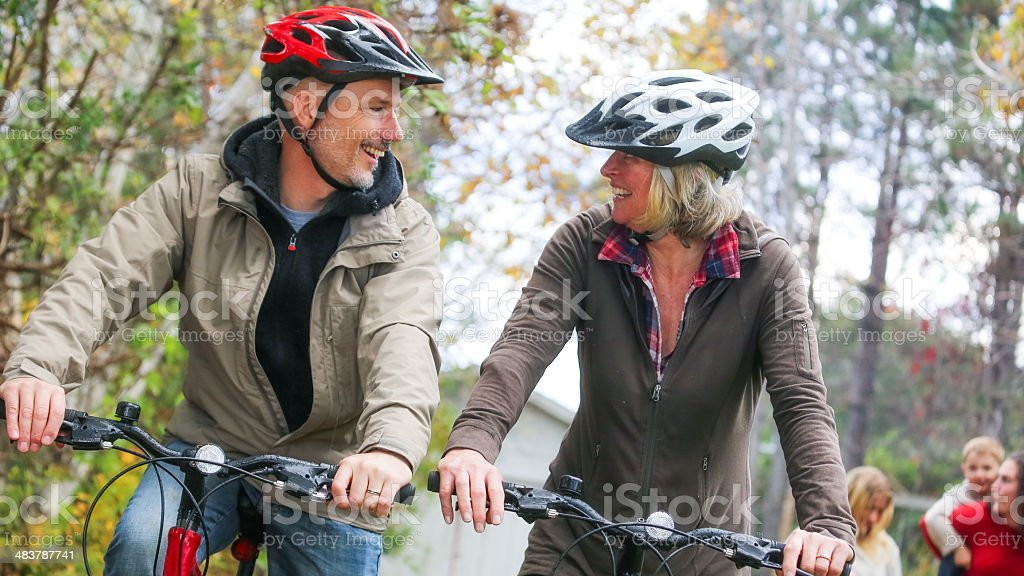 Cute Mature Couple Riding Bikes stock photo