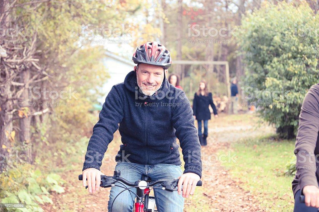 Cute Mature Man Riding Bikes stock photo
