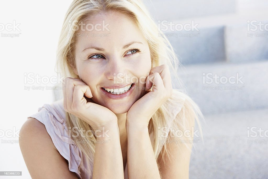Cute mid adult woman looking away royalty-free stock photo
