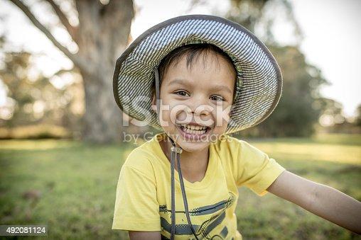 istock Cute mixed race Asian Caucasian boy plays in a park 492081124