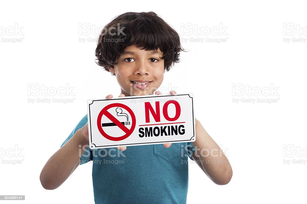Cute Mixed Race Boy with No Smoking Sign. stock photo