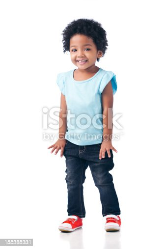 Cute Mixed-race girl with curly afro posing for the camera. Isolated on white.