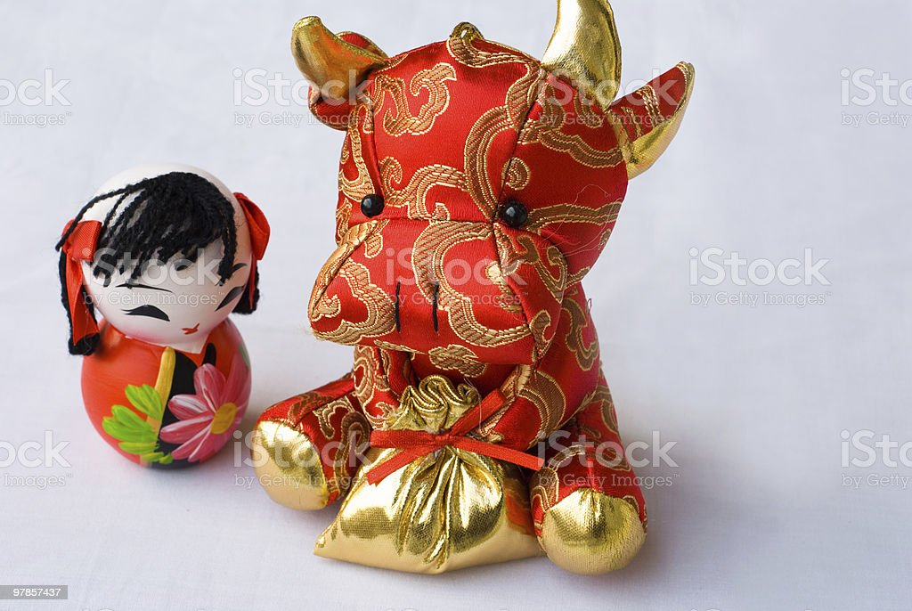 cute moppet and red cow stock photo