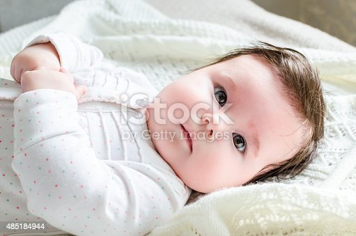 177414958istockphoto Cute newborn baby girl in suit lying on woolen blanket 485184944