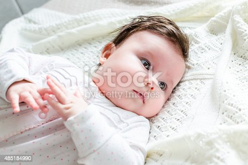 177414958istockphoto Cute newborn baby girl in suit lying on woolen blanket 485184990