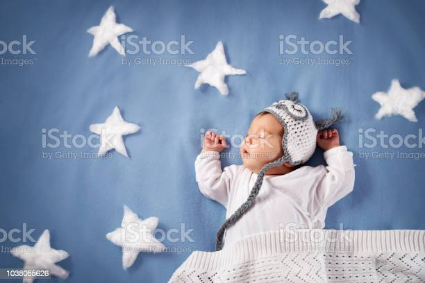 Cute newborn baby girl lying in the bed 2 month old child in owl hat picture id1038055626?b=1&k=6&m=1038055626&s=612x612&h=yu mjjjns krsk g4qf1rwgtccxvdf3b5tpa7k wkmc=